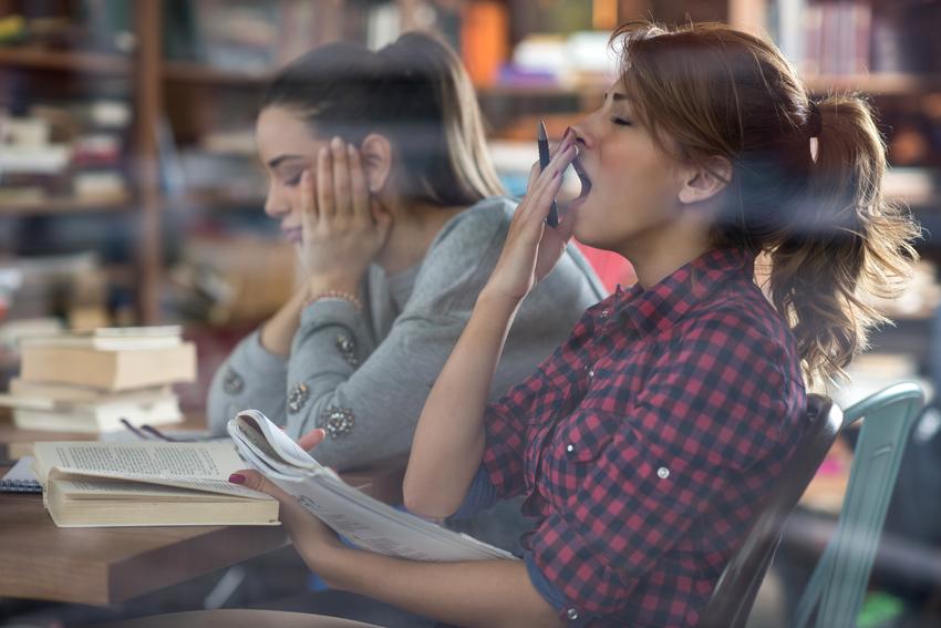 studying and yawning