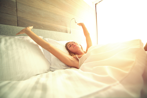 Woman wakes up in a king size mattress